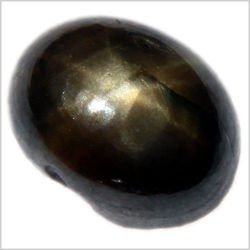 0.88CT OVAL CABOCHON BLACK STAR SAPPHIRE